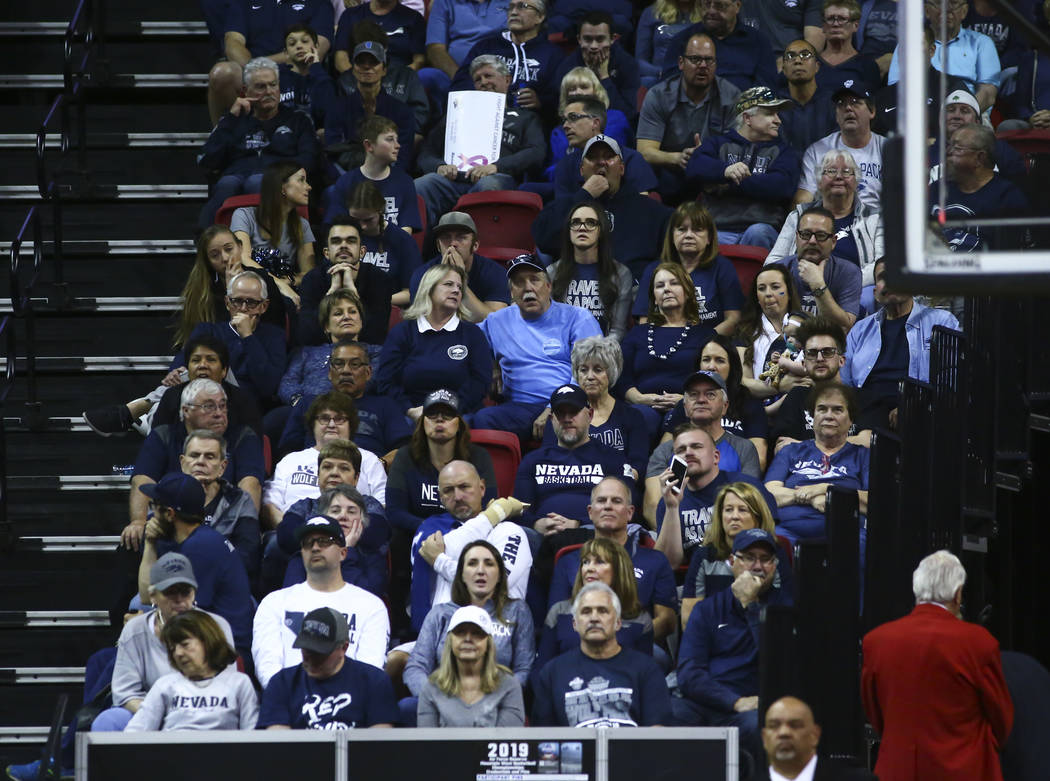 UNR fans react as their team trails against San Diego State during the second half of a semifinal basketball game in the Mountain West men's basketball tournament at the Thomas & Mack Center i ...