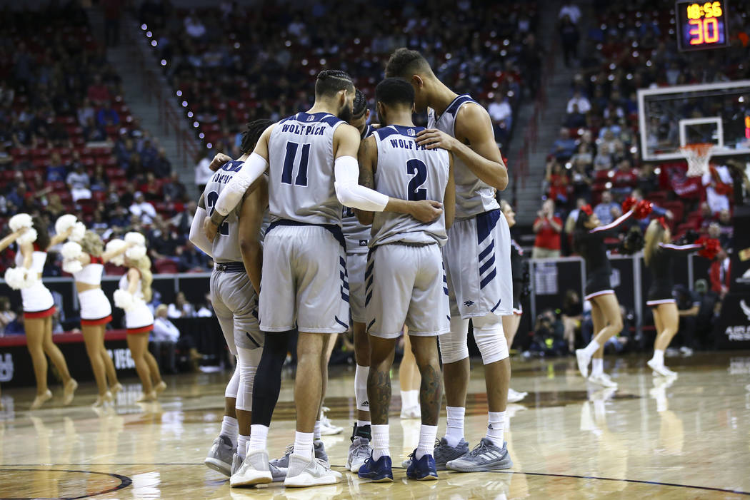UNR players huddle during the second half of a semifinal basketball game against San Diego State in the Mountain West men's basketball tournament at the Thomas & Mack Center in Las Vegas on Fr ...