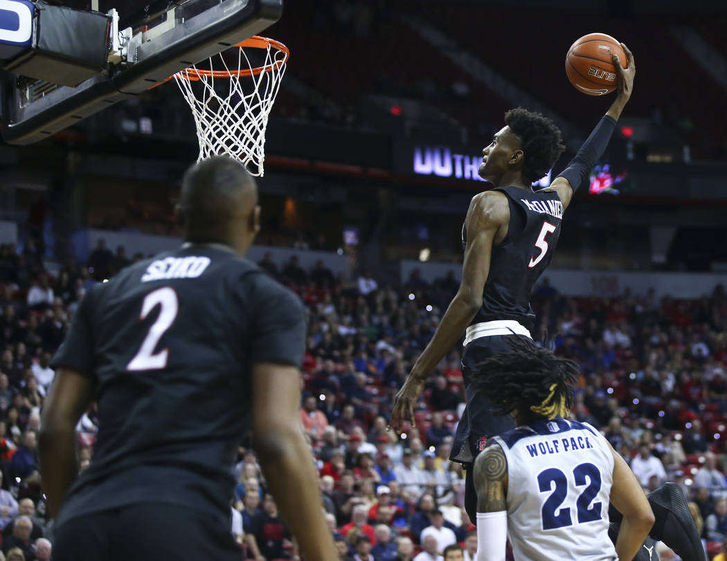 San Diego State Aztecs forward Jalen McDaniels (5) goes to the basket past UNR Wolf Pack guard Jazz Johnson (22) during the first half of a semifinal basketball game in the Mountain West men's bas ...