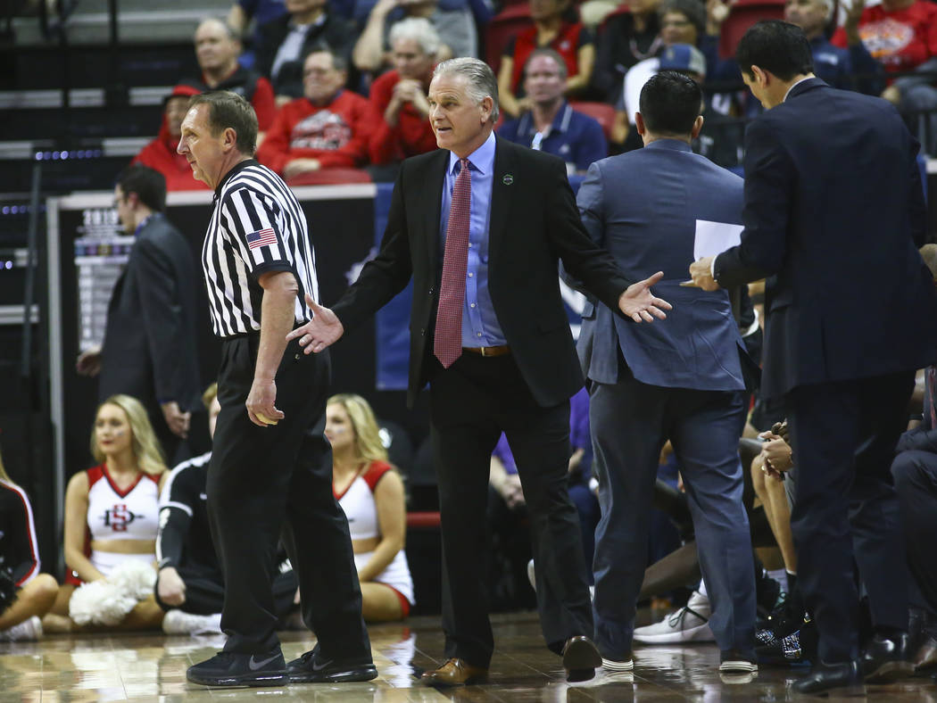 San Diego State Aztecs head coach Brian Dutcher reacts during the first half of a semifinal basketball game against UNR in the Mountain West men's basketball tournament at the Thomas & Mack Ce ...