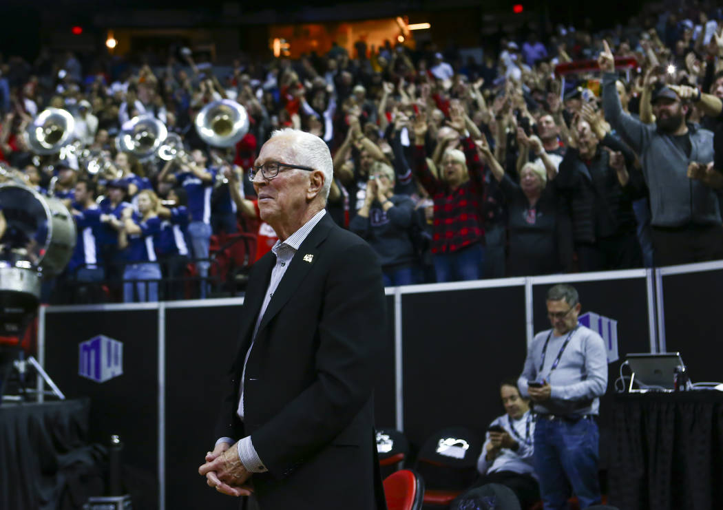Former San Diego State head coach Steve Fisher looks on after SDSU defeated UNR in a semifinal basketball game at the Mountain West men's basketball tournament at the Thomas & Mack Center in L ...