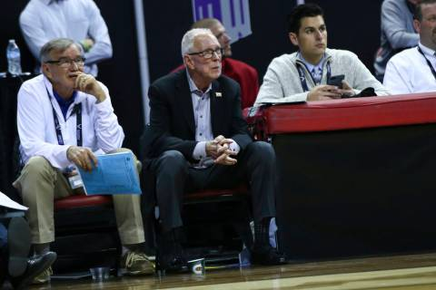 Former San Diego State head coach Steve Fisher looks on during the second half of a semifinal basketball game against UNR in the Mountain West men's basketball tournament at the Thomas & Mack ...