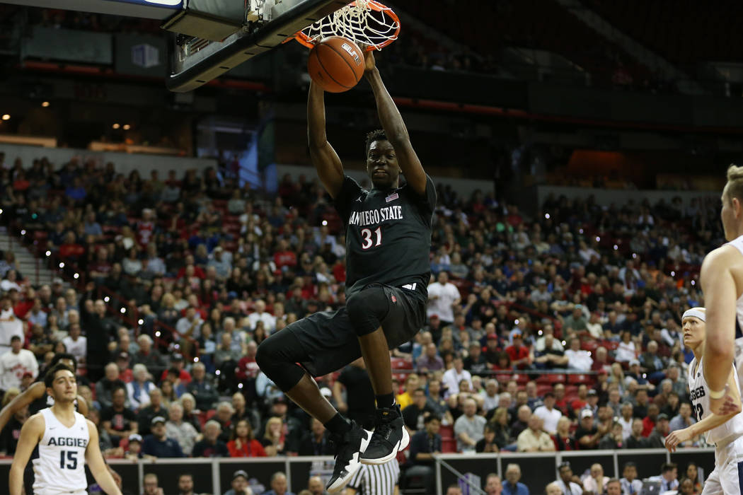 San Diego State Aztecs forward Nathan Mensah (31) dunks the ball against Utah State Aggies in the first half of the Mountain West tournament men's basketball championship game at the Thomas & ...