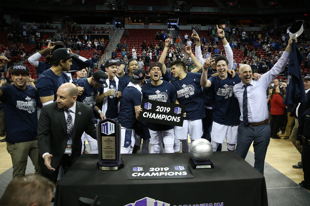 Utah State Aggies celebrate their win against San Diego State Aztecs in the Mountain West tournament men's basketball championship game at the Thomas & Mack Center in Las Vegas, Saturday, Marc ...