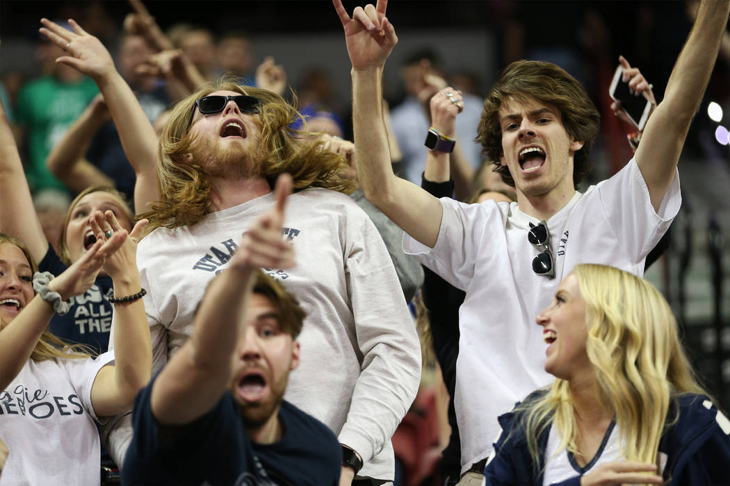 Fans cheer for Utah State Aggies in their game against San Diego State Aztecs in the second half of the Mountain West tournament men's basketball championship game at the Thomas & Mack Center ...