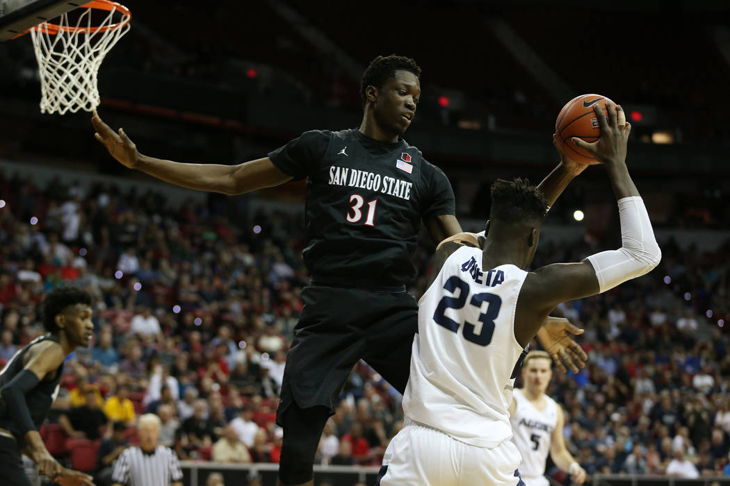 San Diego State Aztecs forward Nathan Mensah (31) defends against Utah State Aggies center Neemias Queta (23) in the second half of the Mountain West tournament men's basketball championship game ...