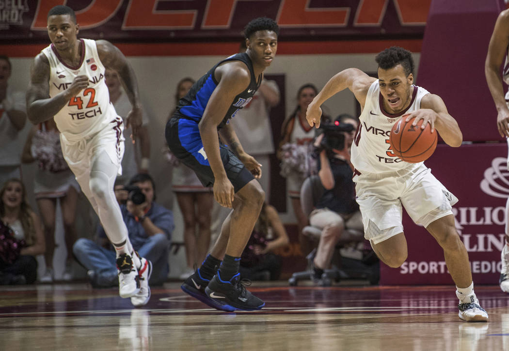 Virginia Tech guard Wabissa Bede (3) starts a fast break near Duke forward RG Barrett during the second half of an NCAA college basketball game in Blacksburg, Va., Tuesday, Feb. 26, 2019. (AP Phot ...