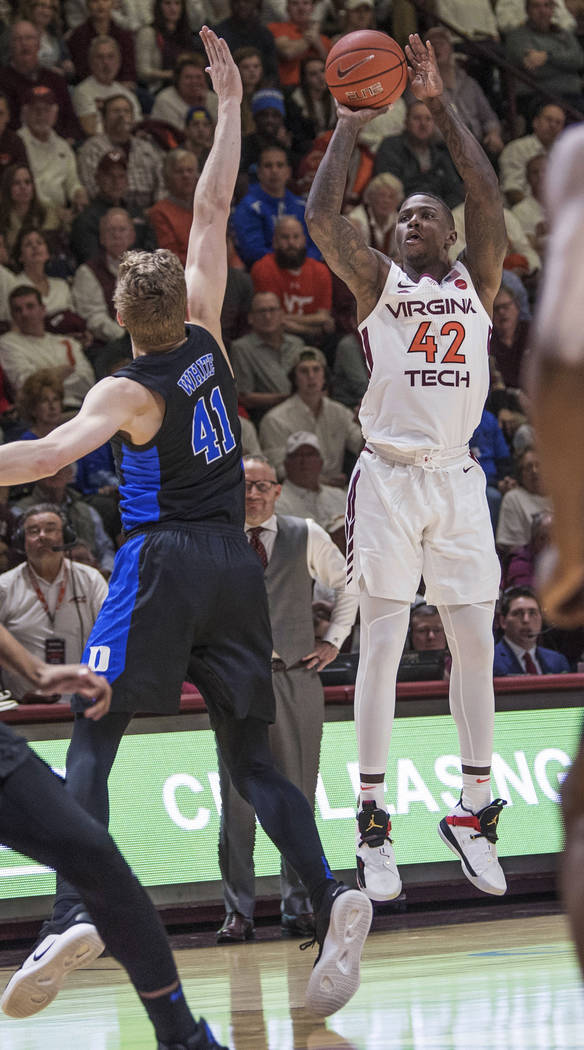 Virginia Tech forward Kerry Backshear Jr (42) shoots a 3-pointer over Duke's Jack White (41) during the first half of an NCAA college basketball game in Blacksburg, Va., Tuesday, Feb. 26, 2019. (A ...