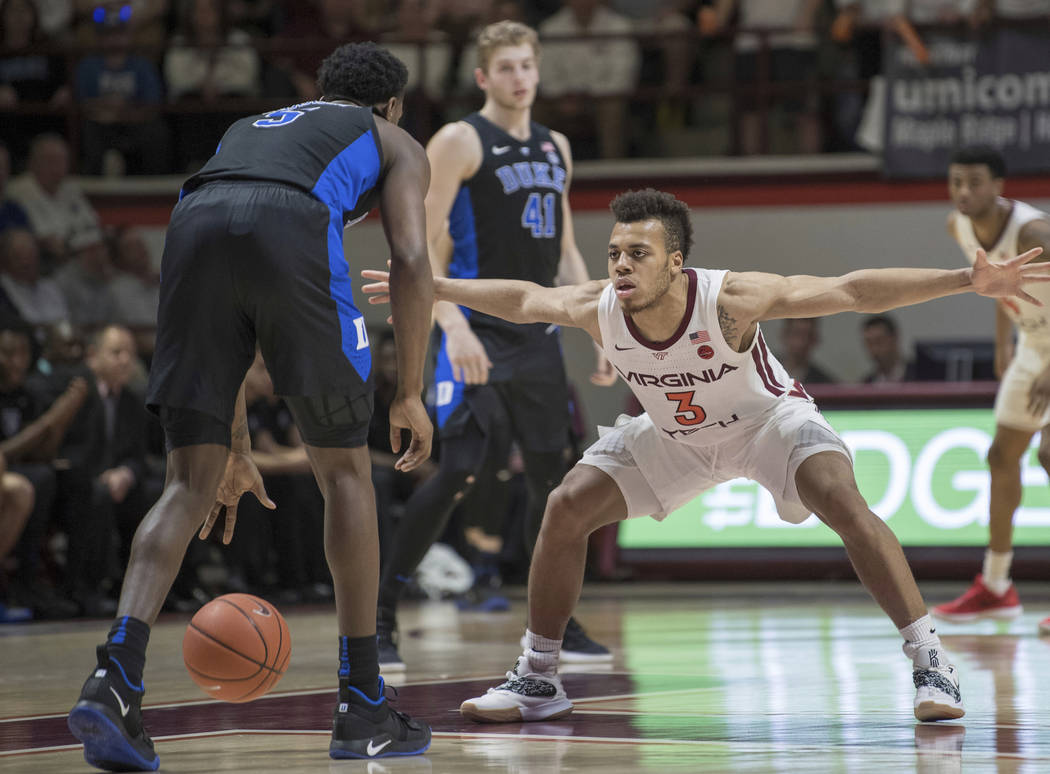 Virginia Tech's Wabissa Bede (3) defends against Duke forward RJ Barrett (5) during the second half of an NCAA college basketball game in Blacksburg, Va., Tuesday, Feb. 26, 2019. (AP Photo/Lee Lut ...