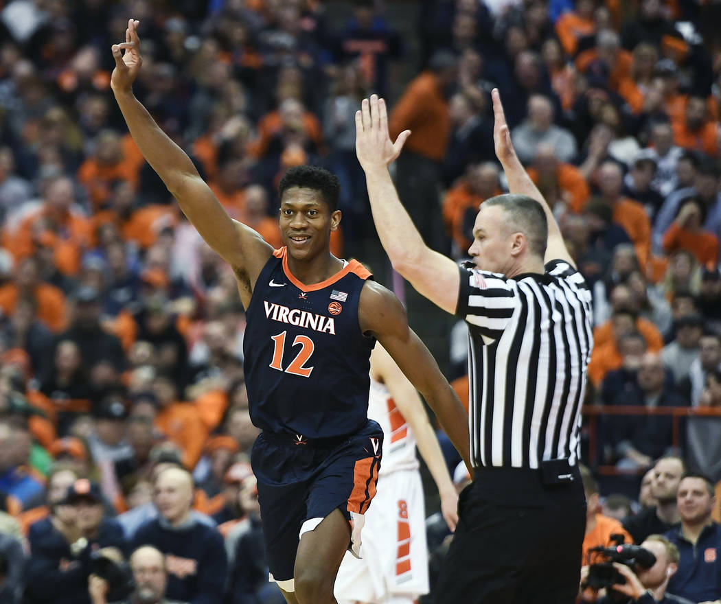 Virginia guard De'Andre Hunter celebrates a three-point basket during the second half of an NCAA college basketball game against Syracuse in Syracuse, N.Y., Monday, March 4, 2019. (AP Photo/Adrian ...
