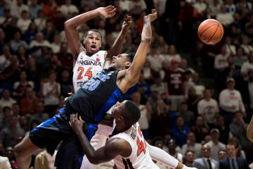 Duke center Marques Bolden (20) is fouled as Virginia Tech's Kerry Blackshear Jr. (24) and Ty Outlaw (42) defend during the first half of an NCAA college basketball game in Blacksburg, Va., Tuesda ...