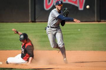 UNR infielder Wyatt Tilley (7) throws the ball to first base after getting out UNLV first baseman Jack-Thomas Wold (19) at second base in the ninth inning during an NCAA baseball game at Earl E. W ...