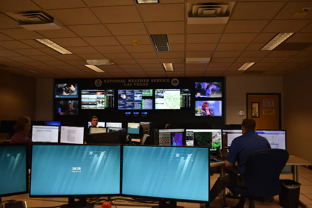 Three meteorologists at their work stations at the Las Vegas National Weather Service office on Dean Martin Drive on Friday, March 1 at 10 a.m. (Rachel Spacek/Las Vegas Review-Journal @Rachel Spacek)
