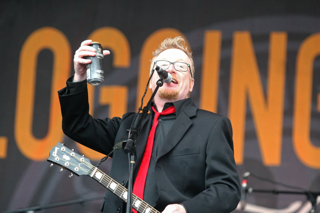 Dave King of Flogging Molly toasts the crowd at the Austin City Limits Music Festival in Austin, Texas on Saturday, Oct. 3, 2009. (AP Photo/Jack Plunkett)