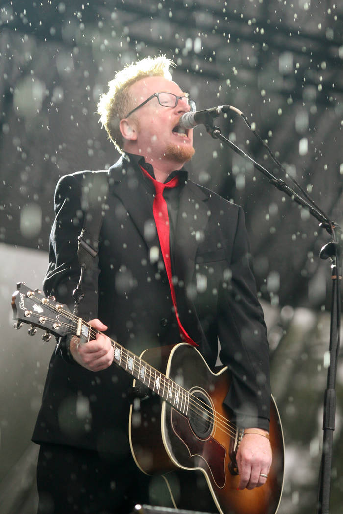 Dave King of Flogging Molly performs in a downpour at the Austin City Limits Music Festival in Austin, Texas on Saturday, Oct. 3, 2009. (AP Photo/Jack Plunkett)