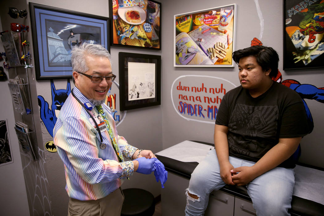 Pulmonologist Dr. Craig Nakamura, director of the Cystic Fibrosis Center of Southern Nevada, examines Rhuniel Getalado, 15, in his Las Vegas office Thursday, March 7, 2019. (K.M. Cannon/Las Vegas ...