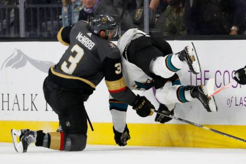 Vegas Golden Knights defenseman Brayden McNabb (3) checks San Jose Sharks right wing Joonas Donskoi (27) during the second period of an NHL hockey game Saturday, Nov. 24, 2018, in Las Vegas. (AP P ...