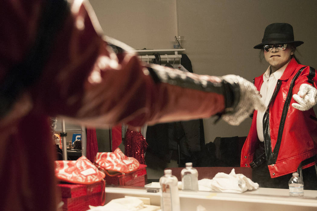 Sean E. Cooper gets ready before entertaining the crowd with his Michael Jackson impression during his show at Sin City Theatre inside Planet Hollywood hotel-casino in Las Vegas, Saturday, Dec. 7, ...