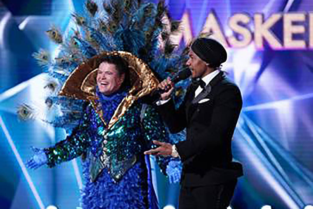 """The Peacock is revealed as Donny Osmond during """"The Masked Singer."""" With Osmond is host Nick Cannon. (Fox)"""