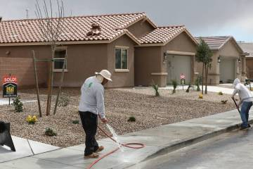Construction workers wash the sidewalk at the new construction site of LGI Homes at the Intersection of E. Lake Mead Boulevard and Dolly Lane photographed on Friday, March. 8, 2019, in Las Vegas. ...