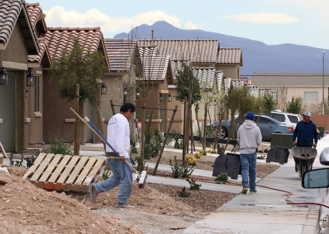 Construction workers at a new LGI Homes construction site at the Intersection of E. Lake Mead Boulevard and Dolly Lane photographed on Friday, March. 8, 2019, in Las Vegas. Bizuayehu Tesfaye Las V ...