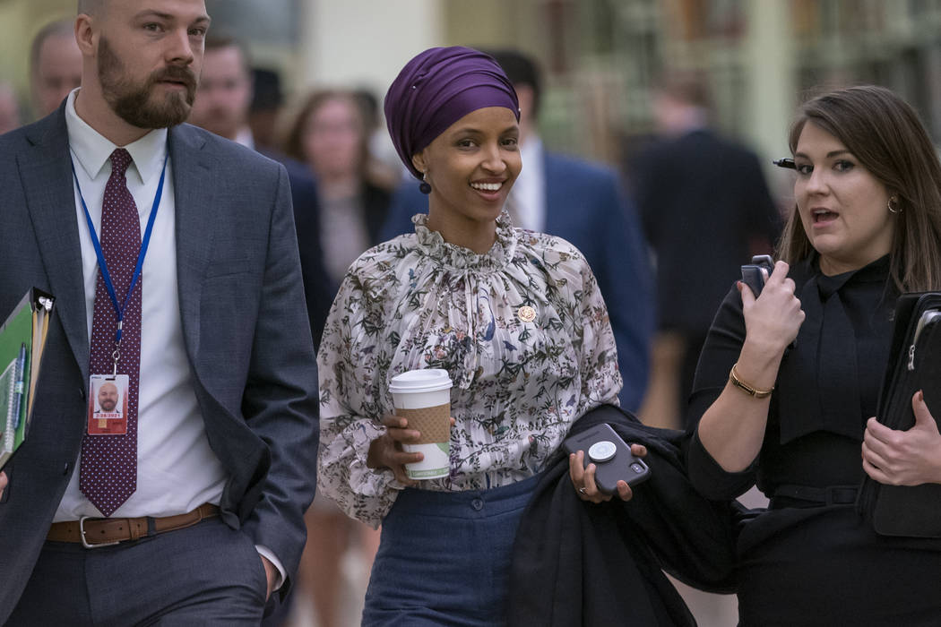 Rep. Ilhan Omar, D-Minn., walks through an underground tunnel at the Capitol as top House Democrats plan to offer a measure that condemns anti-Semitism in the wake of controversial remarks by the ...