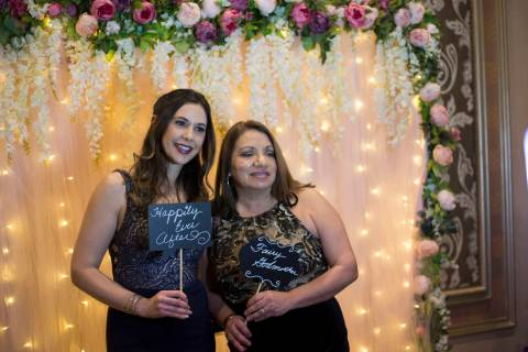 Stephanie Coronado, left, poses in a photo booth with her mother-in-law Anita Coronado, right, at a fundraising gala for Living Grace Homes, an organization that helps homeless women and children, ...