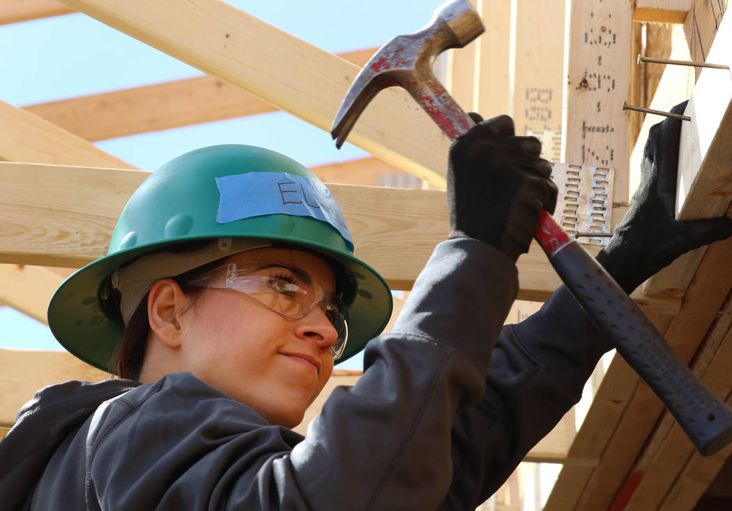 Ellie Lukova of the Las Vegas Aces hammers a nail as she volunteers to help with the construction of Habitat for Humanity Las Vegas' 112th home in celebration of International Women's Day on F ...