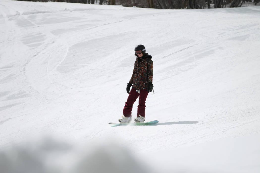 A person snowboards down a hill at Lee Canyon in Las Vegas, Friday, March 8, 2019. Erik Verduzco Las Vegas Review-Journal @Erik_Verduzco