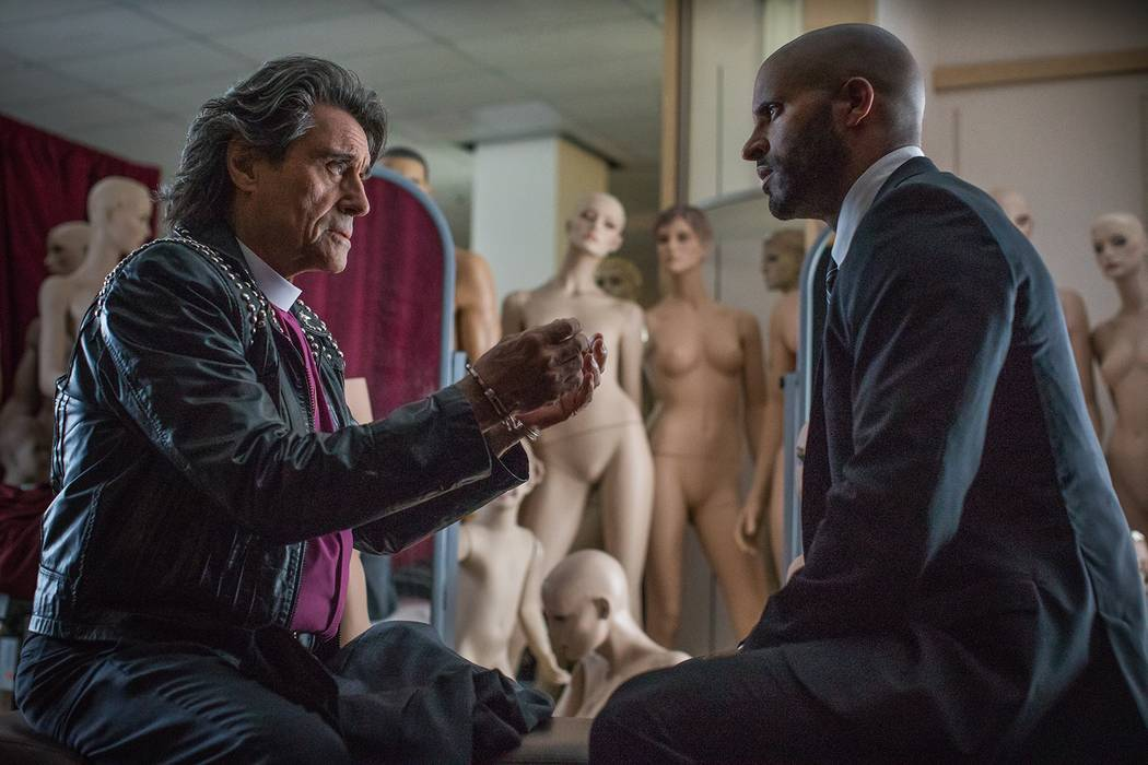"Mr. Wednesday (Ian McShane), left, and Shadow Moon (Ricky Whittle) appear in a scene from ""American Gods."" (Starz)"