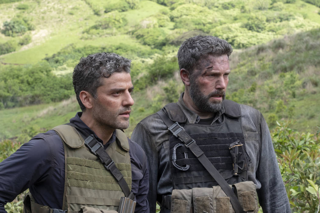 "TRIPLE FRONTIER (2019) - pictured L-R: Oscar Isaac (""Pope"") and Ben Affleck (""Redfly"") (Melinda Sue Gordon/Netflix) TF_DAY37-0495.RAF"