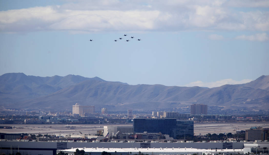 The U.S. Navy Blue Angels fly over the Hard Rock Hotel and McCarran International Airport in Las Vegas Friday, March 8, 2019. (K.M. Cannon/Las Vegas Review-Journal) @KMCannonPhoto