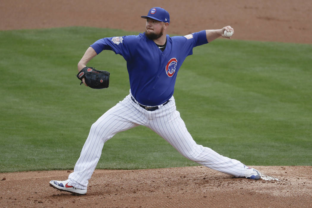 Chicago Cubs starting pitcher Jon Lester throws against the Milwaukee Brewers during the first inning of a spring baseball game in Mesa, Ariz., Saturday, March 2, 2019. (AP Photo/Chris Carlson)
