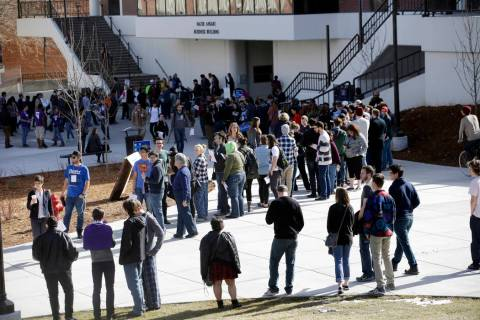 People line up to participate in the Democratic caucus at the University of Nevada in Reno, Feb. 20, 2016. Nevada Democrats are proposing major changes to their presidential caucuses that could d ...