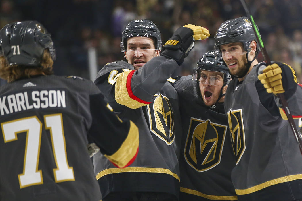 Golden Knights right wing Mark Stone, second from left, celebrates the goal scored by defenseman Shea Theodore, right, with their teammates center William Karlsson (71) and center Jonathan March ...