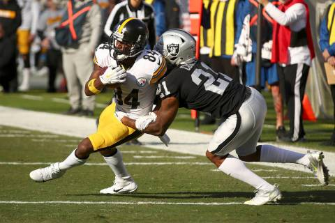 Pittsburgh Steelers wide receiver Antonio Brown (84) runs against Oakland Raiders cornerback Gareon Conley (21) during the first half of an NFL football game in Oakland, Calif., Sunday, Dec. 9, 20 ...