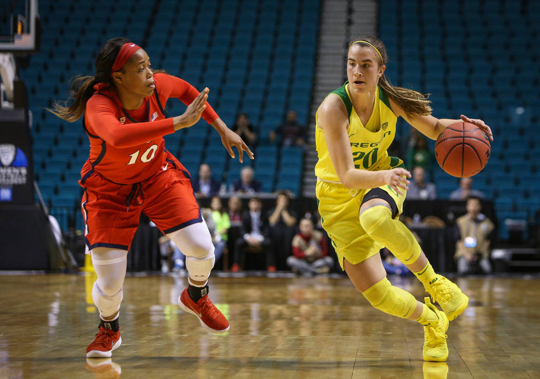 Oregon Ducks guard Sabrina Ionescu (20) dribbles with the ball down the court while being guarded by Arizona Wildcats forward Tee Tee Starks (10) during the second half of an NCAA college basketba ...