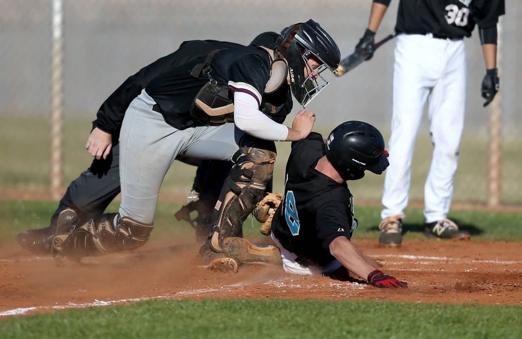 Faith Lutheran catcher Carson Bonus (6) tags out Silverado baserunner Brant Hunt (18) at home during a baseball game at Silverado High School in Las Vegas Friday, March 8, 2019. (K.M. Cannon/Las V ...