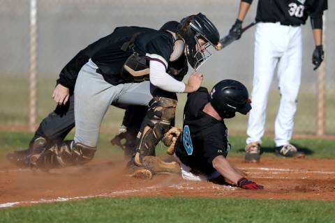 Faith Lutheran catcher Carson Bonus (6) tags out Silverado baserunner Brant Hunt (18) at home during a baseball game at Silverado High School in Las Vegas Friday, March 8, 2019. (K.M. Cannon/Las V ...