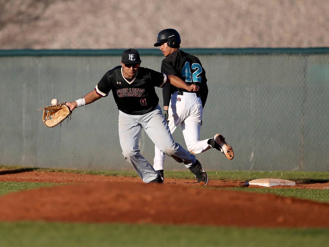 Silverado baserunner Caleb Hubbard (42) crosses first base as Faith Lutheran first baseman Jacob Ortega (8) fields a short hop during a baseball game at Silverado High School in Las Vegas Friday, ...