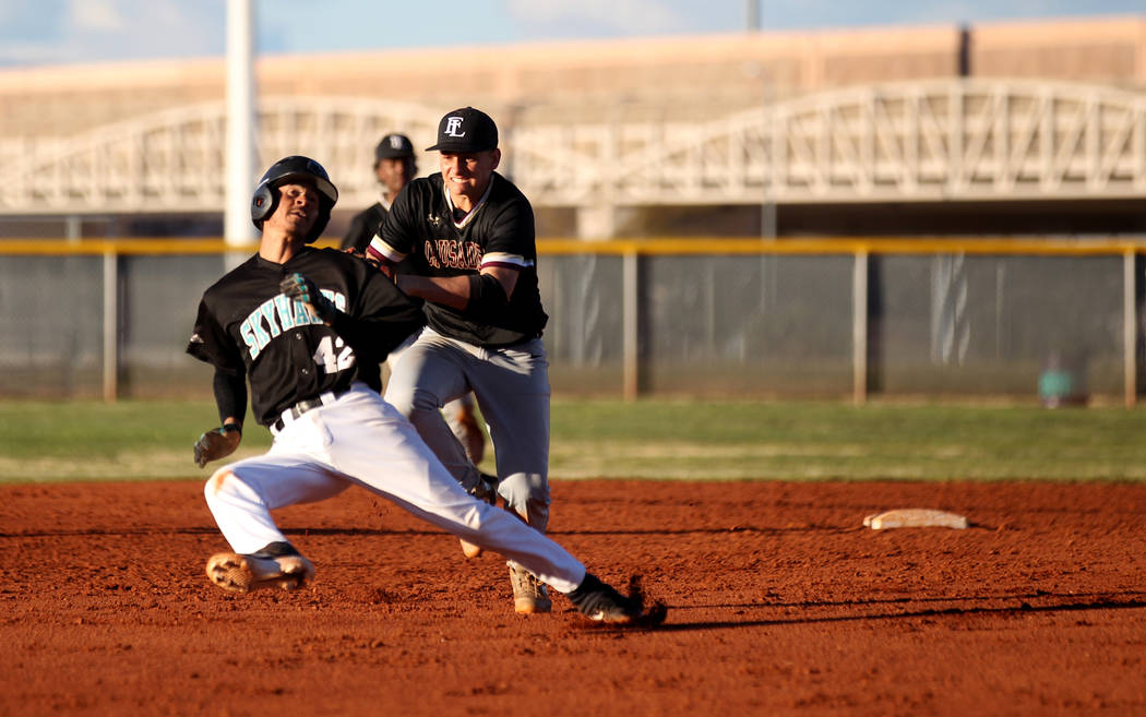 Faith Lutheran shortstop Parker Sylvester (5) tags out Silverado baserunner Caleb Hubbard (42) in a rundown during a baseball game at Silverado High School in Las Vegas Friday, March 8, 2019. (K.M ...