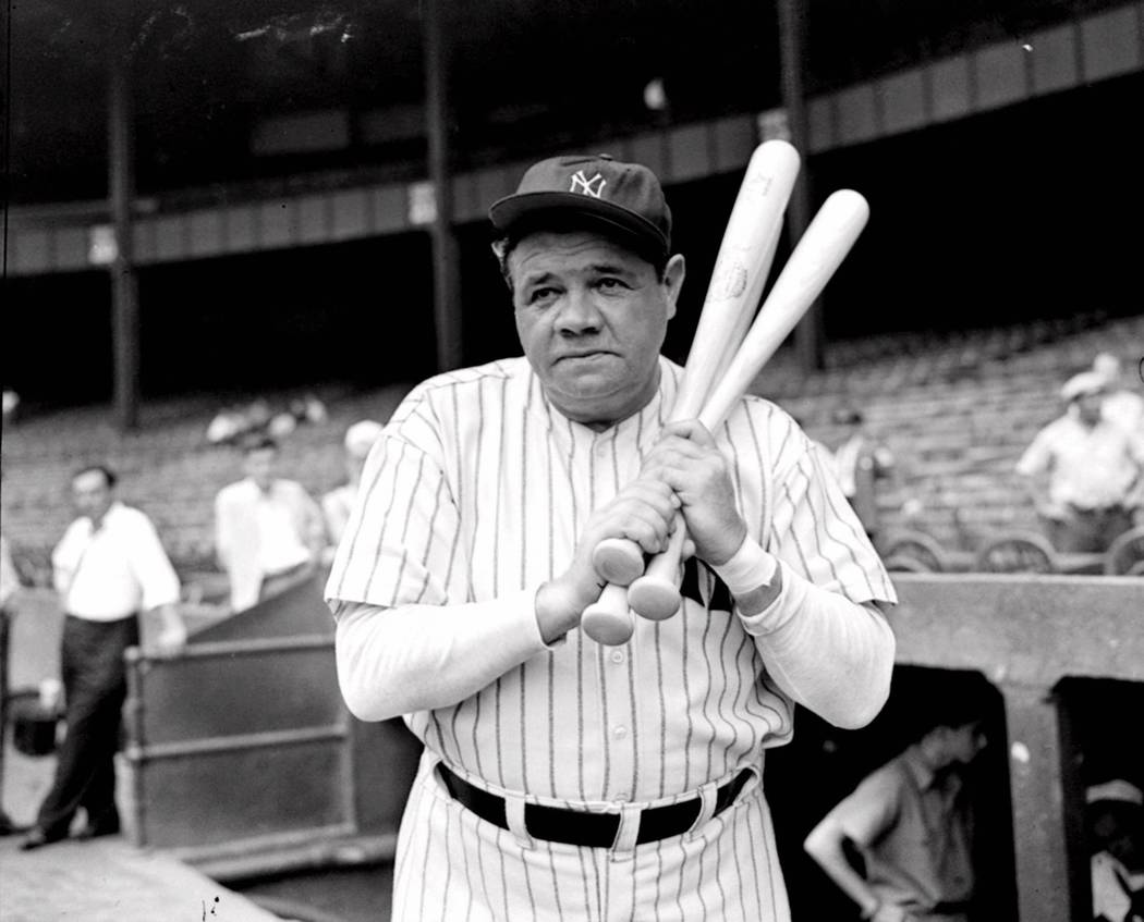 FILE -- Retired Yankees slugger Babe Ruth warms up with three bats before stepping to the plate at New York's Yankee Stadium, August 21, 1942, as he prepared for a hitting exhibition. Before Pedro ...