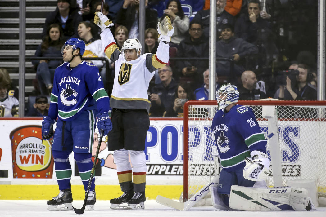 Vegas Golden Knights' Tomas Nosek (92) celebrates his goal near Vancouver Canucks goaltender Jacob Markstrom (25) during the first period of an NHL hockey game in Vancouver, British Columbia, Satu ...