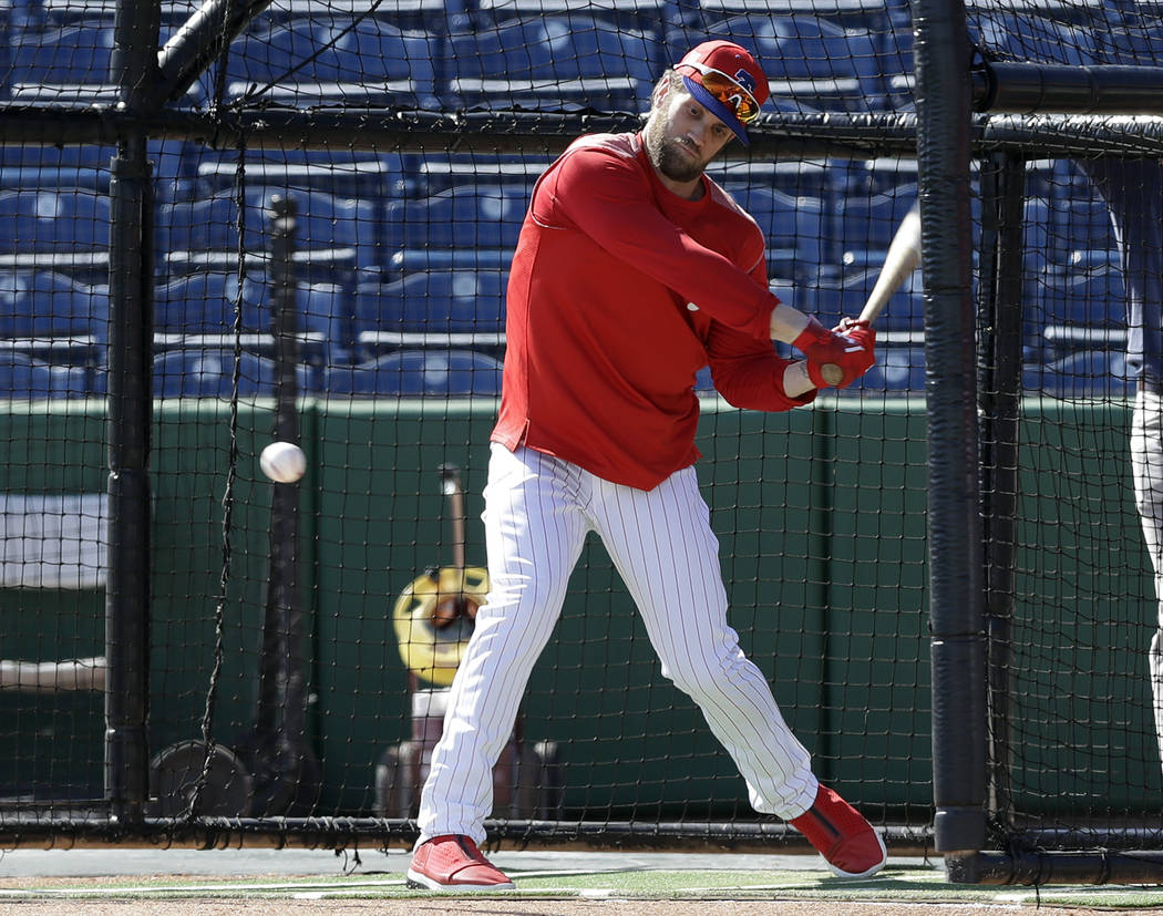 Philadelphia Phillies' Bryce Harper hits in the batting cage before a spring training baseball game against the Toronto Blue Jays Saturday, March 9, 2019, in Clearwater, Fla. (AP Photo/Chris O'Meara)
