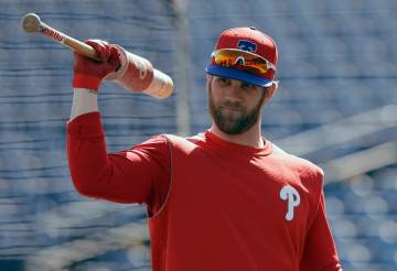 Philadelphia Phillies' Bryce Harper waits his turn in the batting cage before a spring training baseball game against the Toronto Blue Jays Saturday, March 9, 2019, in Clearwater, Fla. (AP Photo/C ...