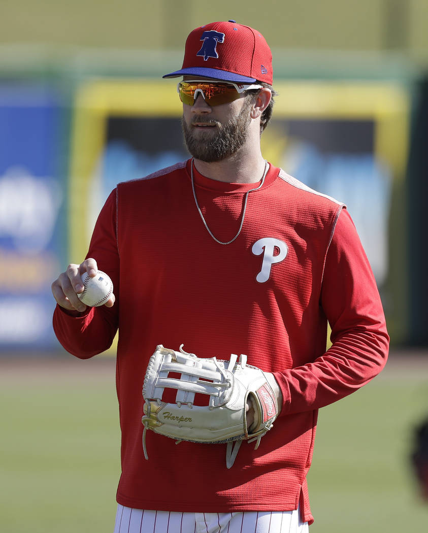 Philadelphia Phillies' Bryce Harper gets ready to throw a ball before a spring training baseball game against the Toronto Blue Jays Saturday, March 9, 2019, in Clearwater, Fla. (AP Photo/Chris O'M ...