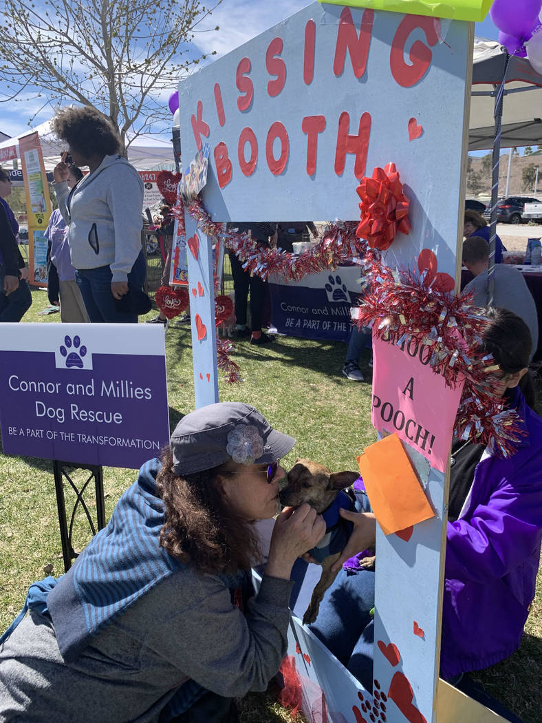 Faith Goffstein, a Las Vegas resident and self-proclaimed dog lover, poses with Romeo, a 2-year-old chihuahua mix up for adoption at Connor and Millieճ Dog Rescue tent at the 16th annual Bar ...