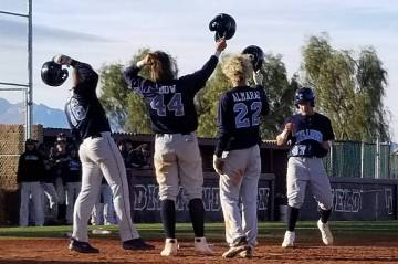 Centennial playes Sam Simon (16), Kris Bow (42) and Rene Almarez (22) greet teammate Austin Kryszczuk after his two-run home run in the second inning against Arbor View on Saturday, March 9, 2019 ...