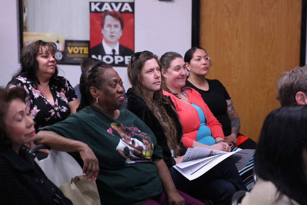 People listen to Washington Gov. Jay Inslee, a Democratic presidential candidate, speaks on climate change at the Nevada Conservation League offices in Las Vegas, Saturday, March 9, 2019. Erik Ver ...