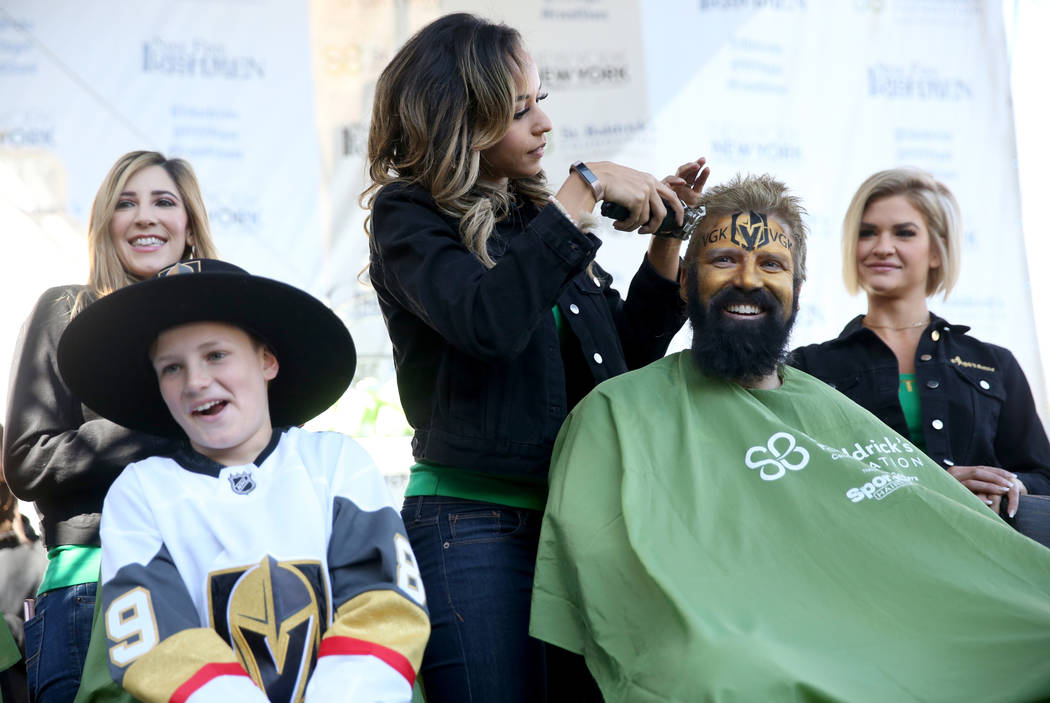 John McManus of Las Vegas gets his head shaved by Ashton of the show Fantasy during St. Baldrick's Foundation shave-a-thon on the Brooklyn Bridge at New York-New York in Las Vegas, Saturday, March ...